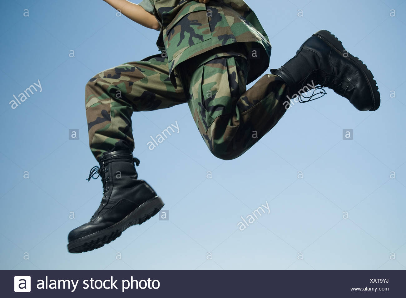 Army soldier jumping - Stock Image