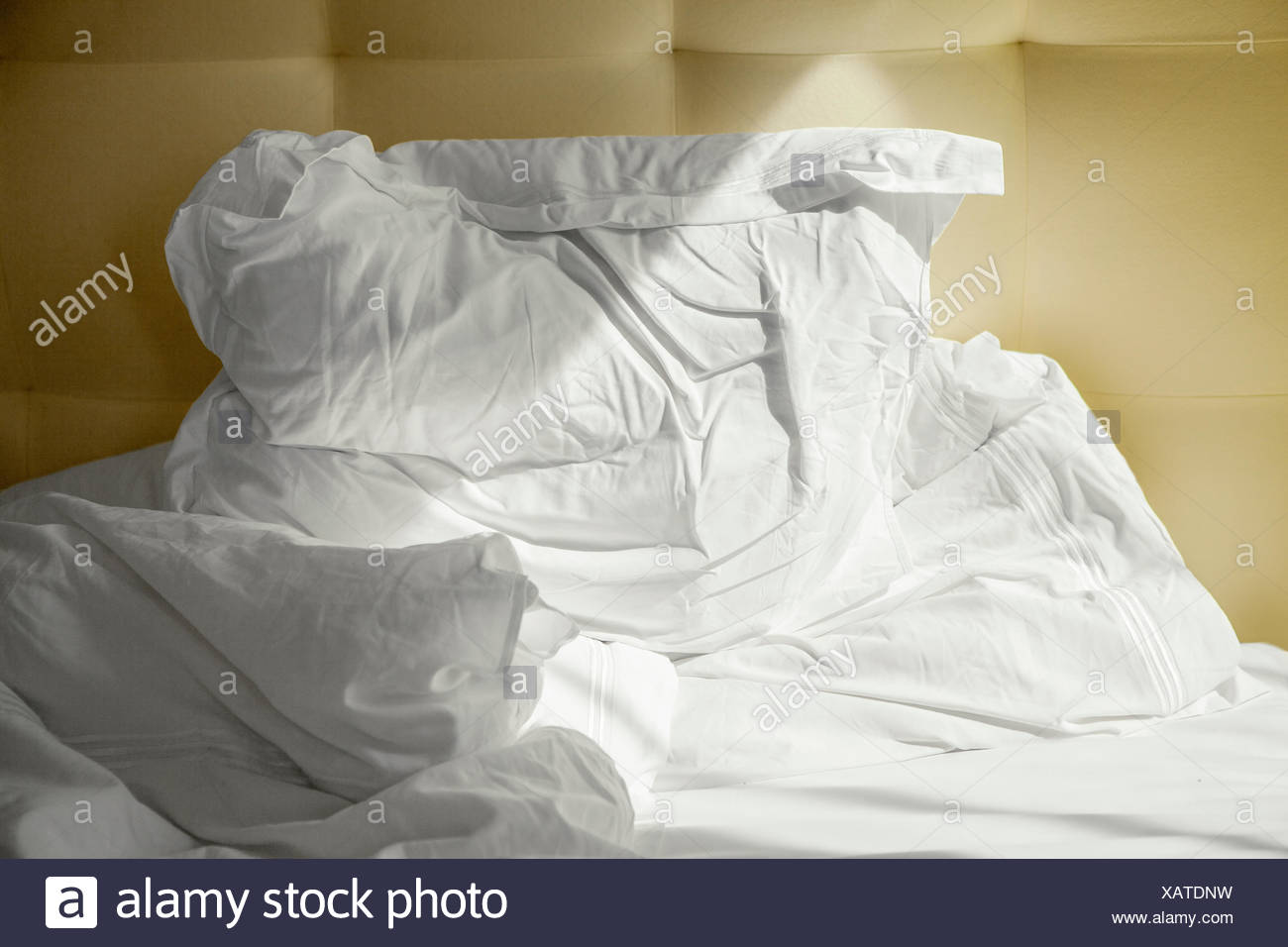 Messy bed - Stock Image