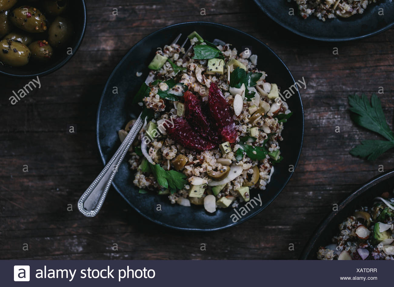 A one-person portion of the Avocado and Quinoa salad with blood oranges and fennel is photographed from the top. - Stock Image