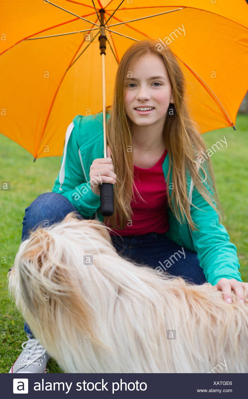 Portrait of a girl pampering her dog - Stock Image
