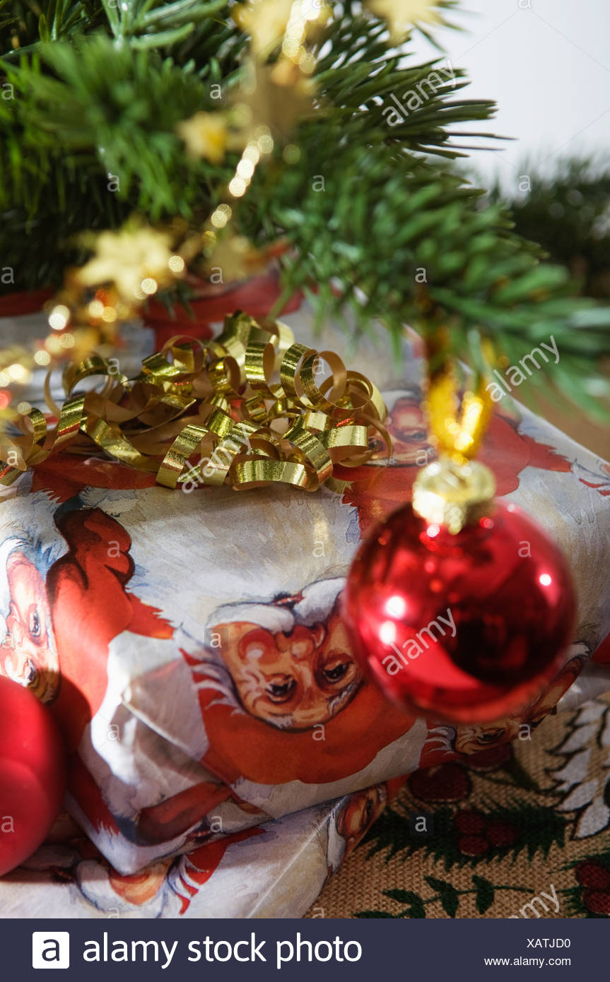 gifts under christmas tree stock image