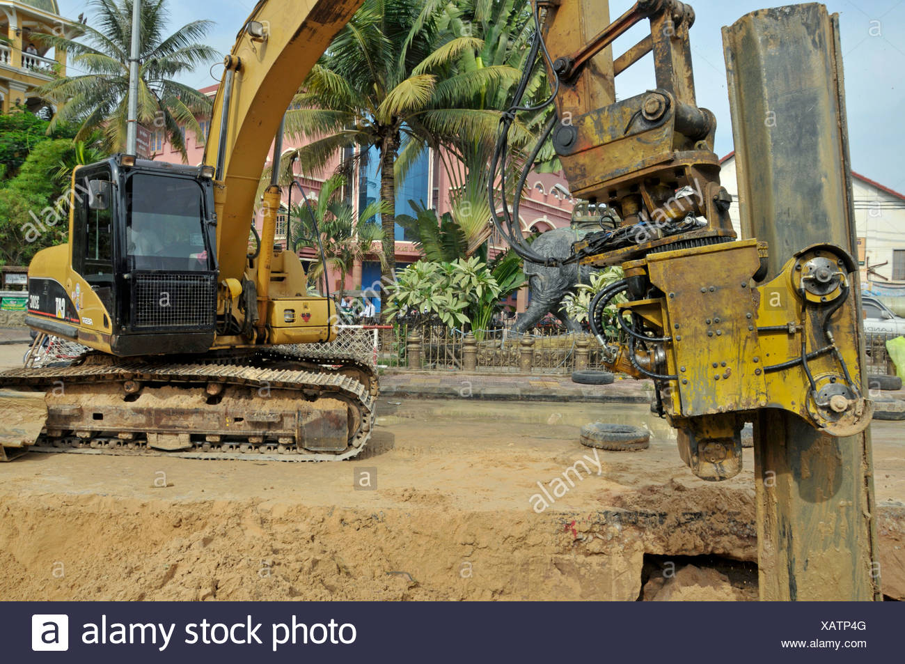Working device professional life Asia excavator Cambodia Mekong region metal wall metal walls Siem Reap excavation pit - Stock Image