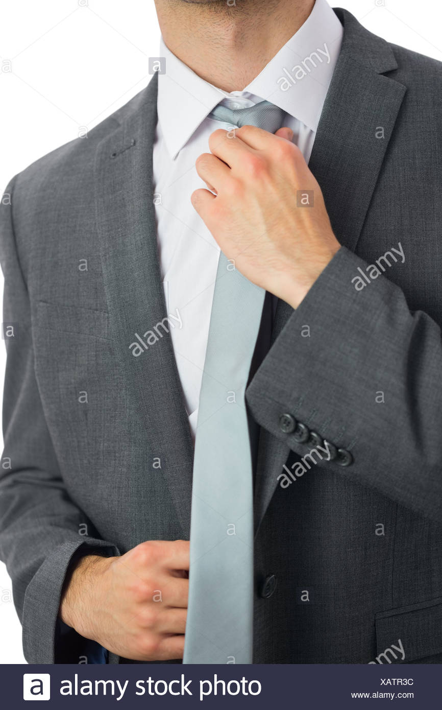 20d9dace6e3a Close up of businessman adjusting blue tie Stock Photo: 282057424 ...