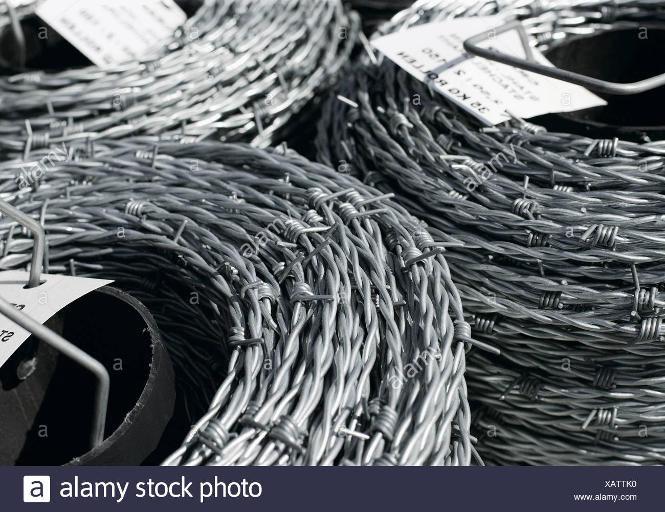 Coils of barb wire, close up Stock Photo: 282058644 - Alamy