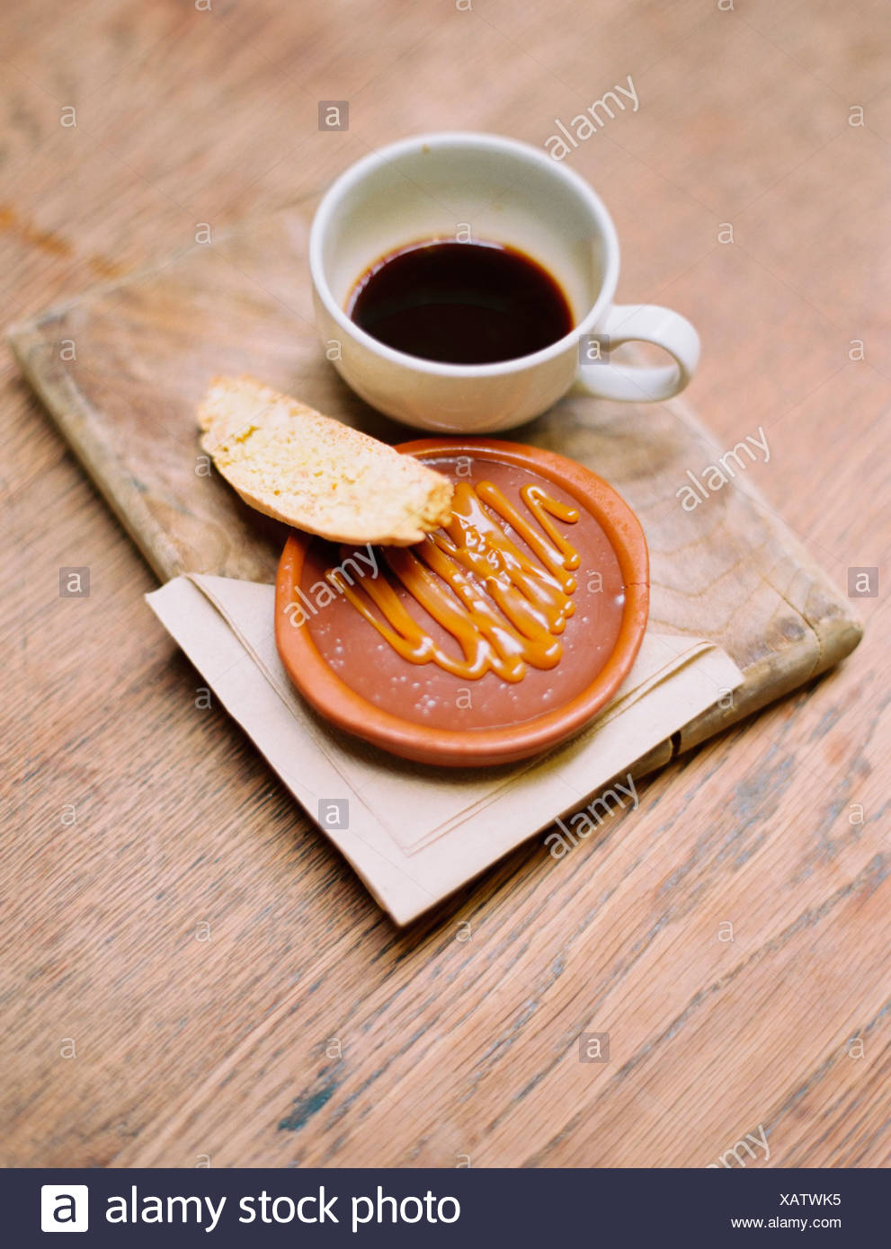 A slice of bread honey or sweet paste and a cup of coffee. - Stock Image