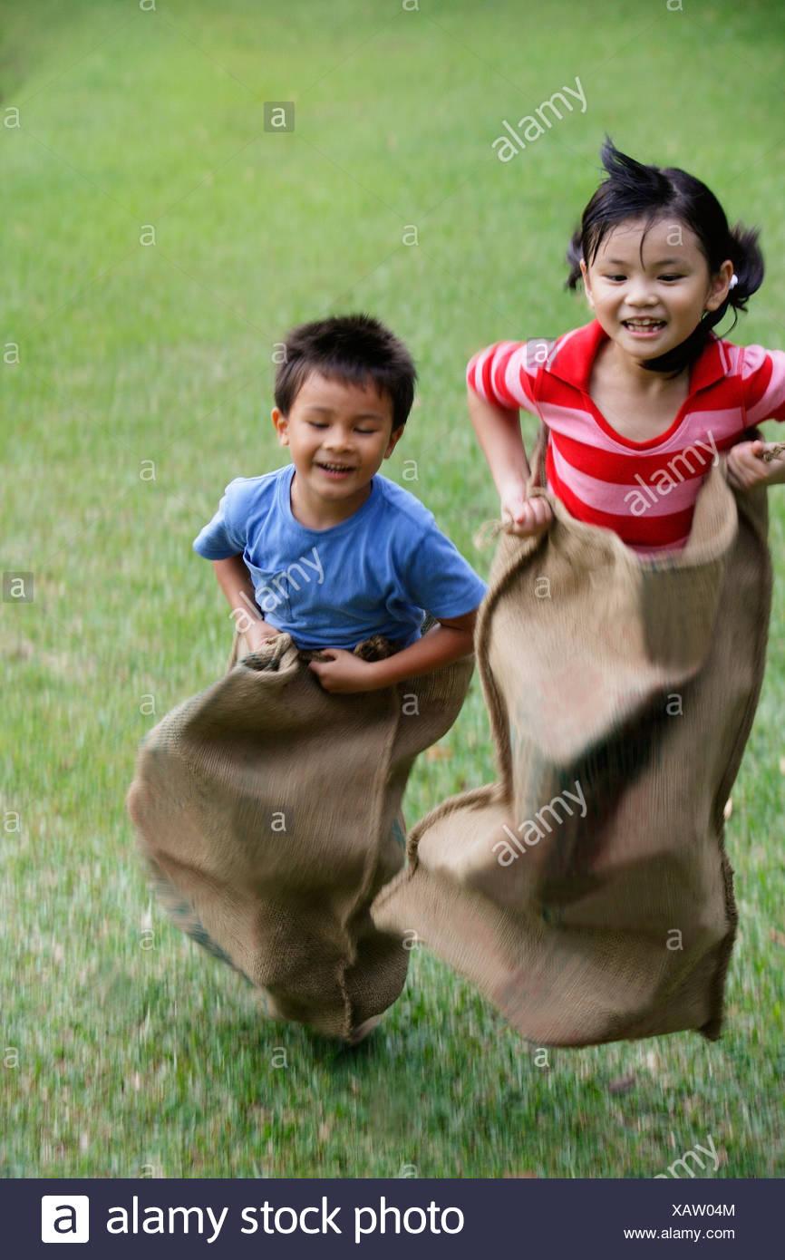 Kids having sack race - Stock Image