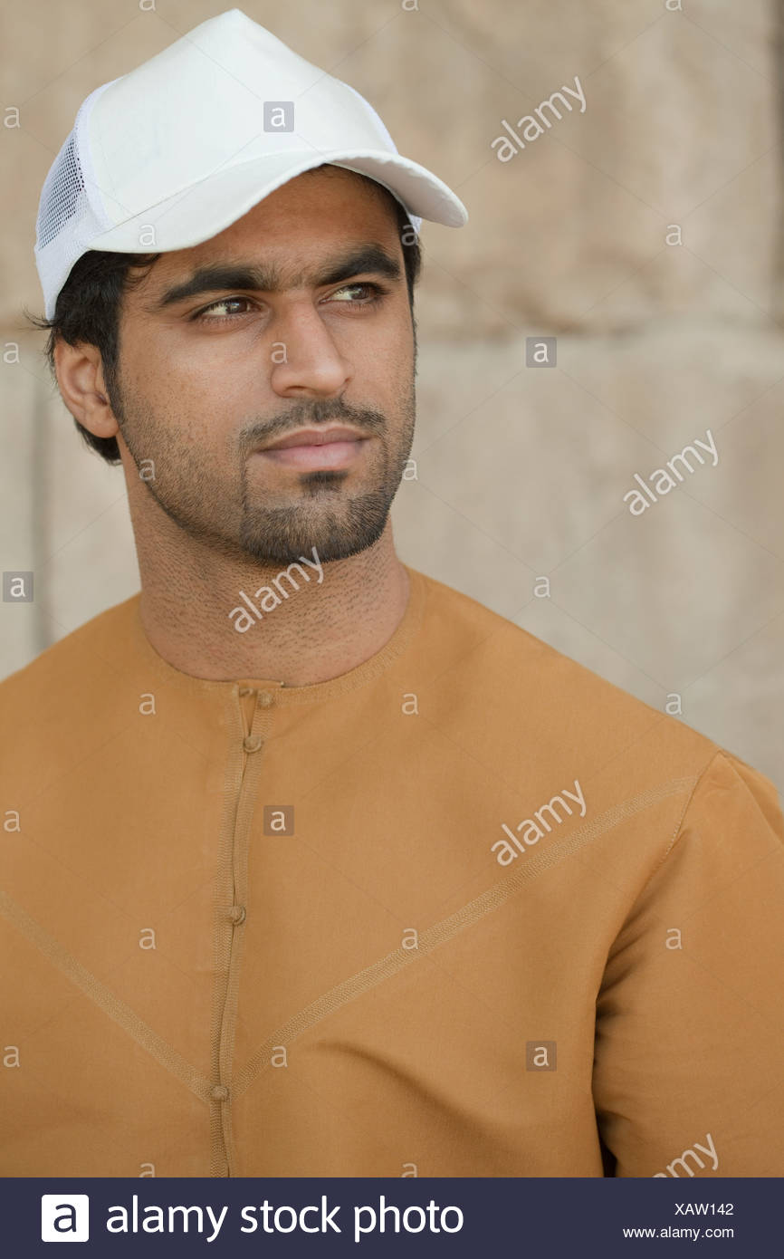 Middle Eastern man wearing cap, portrait - Stock Image