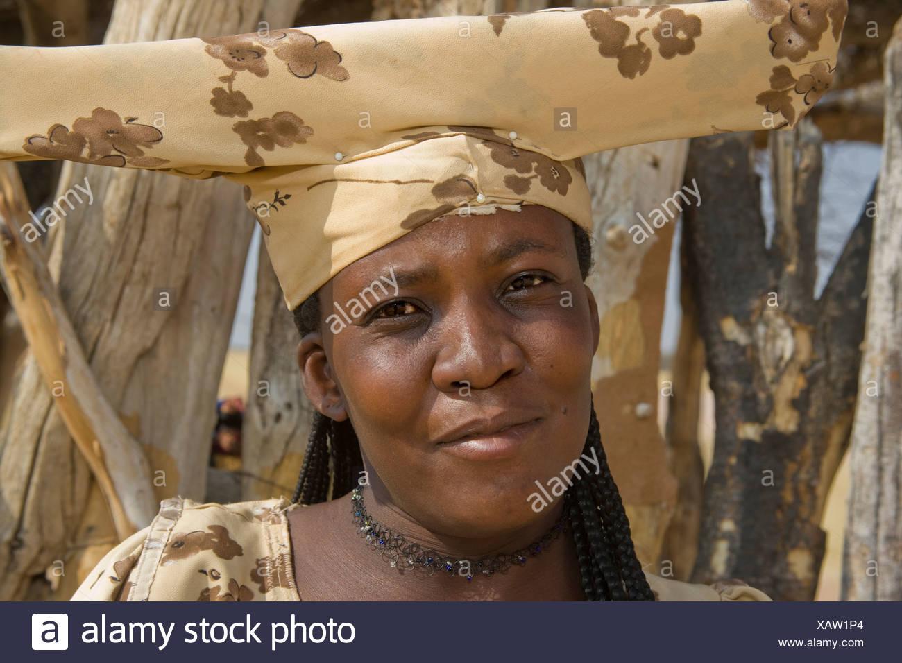 Herrero Woman in Tribal Dress near Okonjima, Namibia - Stock Image