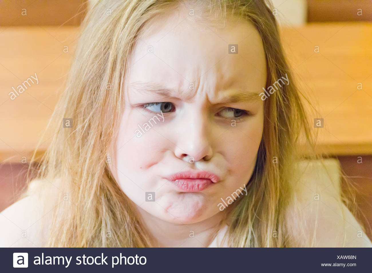 Discontented younger schoolgirl - Stock Image
