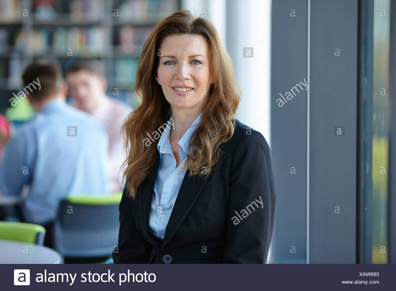 Portrait of mature businesswoman with long hair - Stock Image