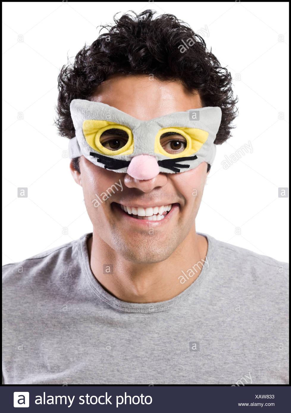man wearing a kitty cat mask - Stock Image