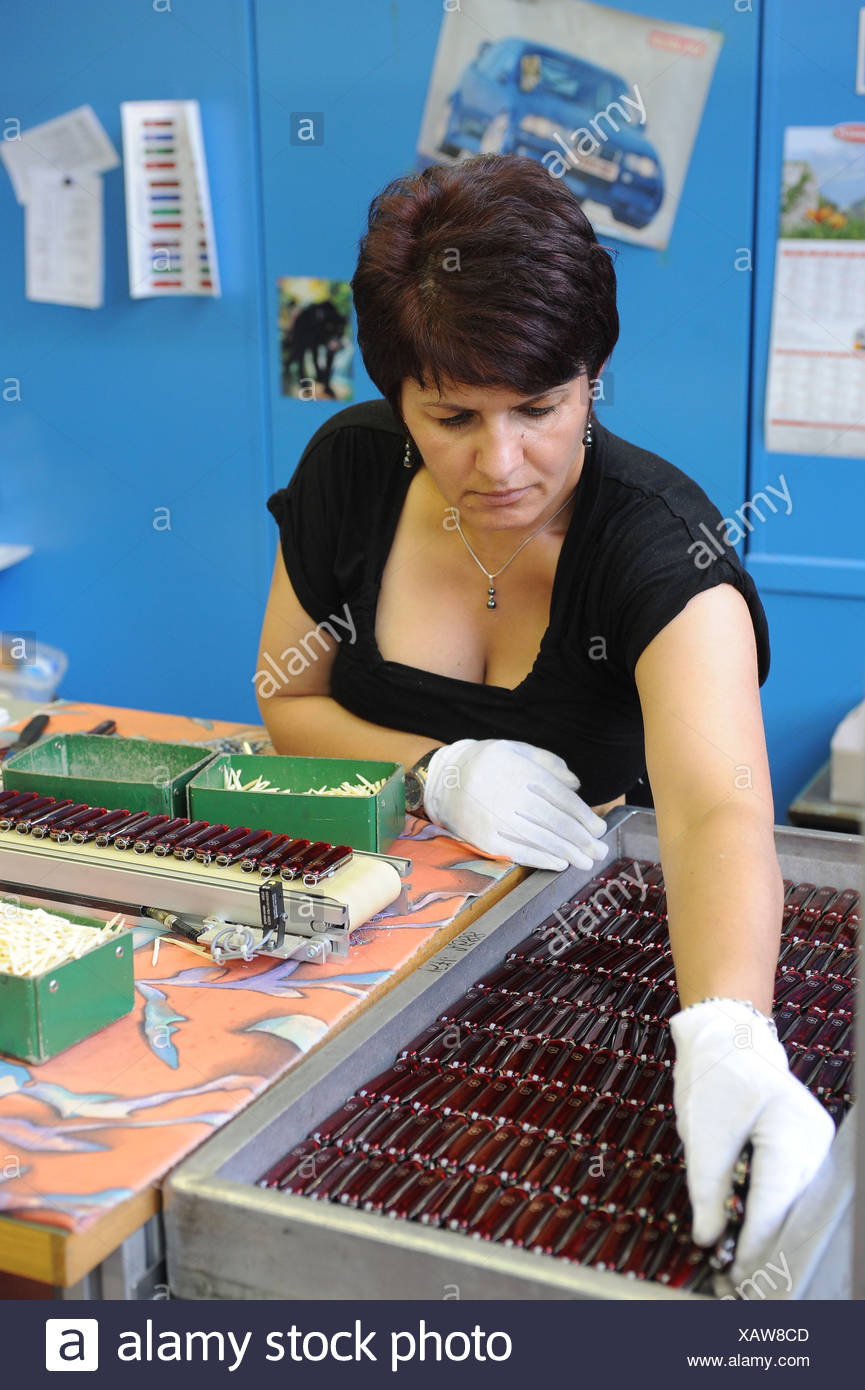 Schwyz, Switzerland, a woman wrapped finished pocket knife Victorinox Stock Photo