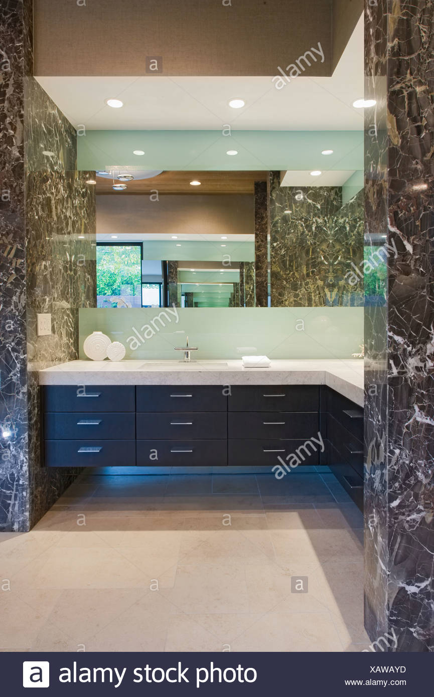 Storage units and mirror in bathroom of California home & Storage units and mirror in bathroom of California home Stock Photo ...