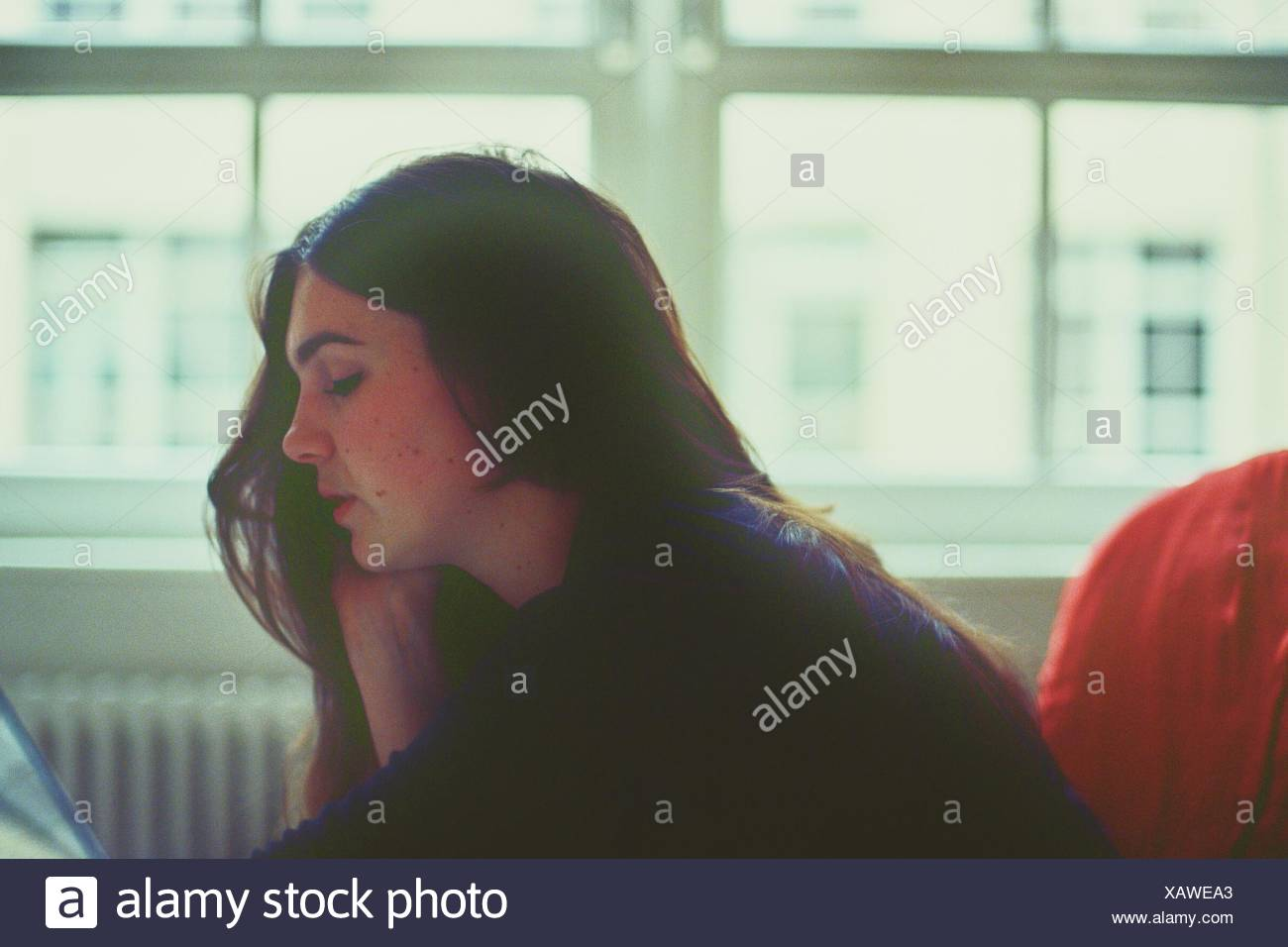 Side View Of Woman With Hand On Chin - Stock Image