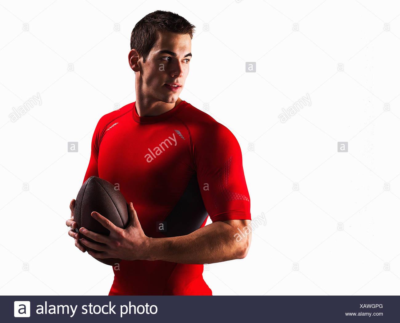 Athletic man holding football Stock Photo