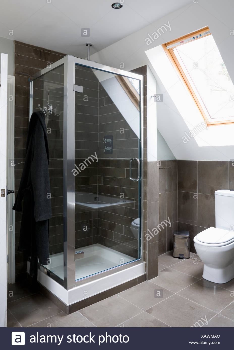 Limestone floor and wall tiles in modern loft conversion shower room ...