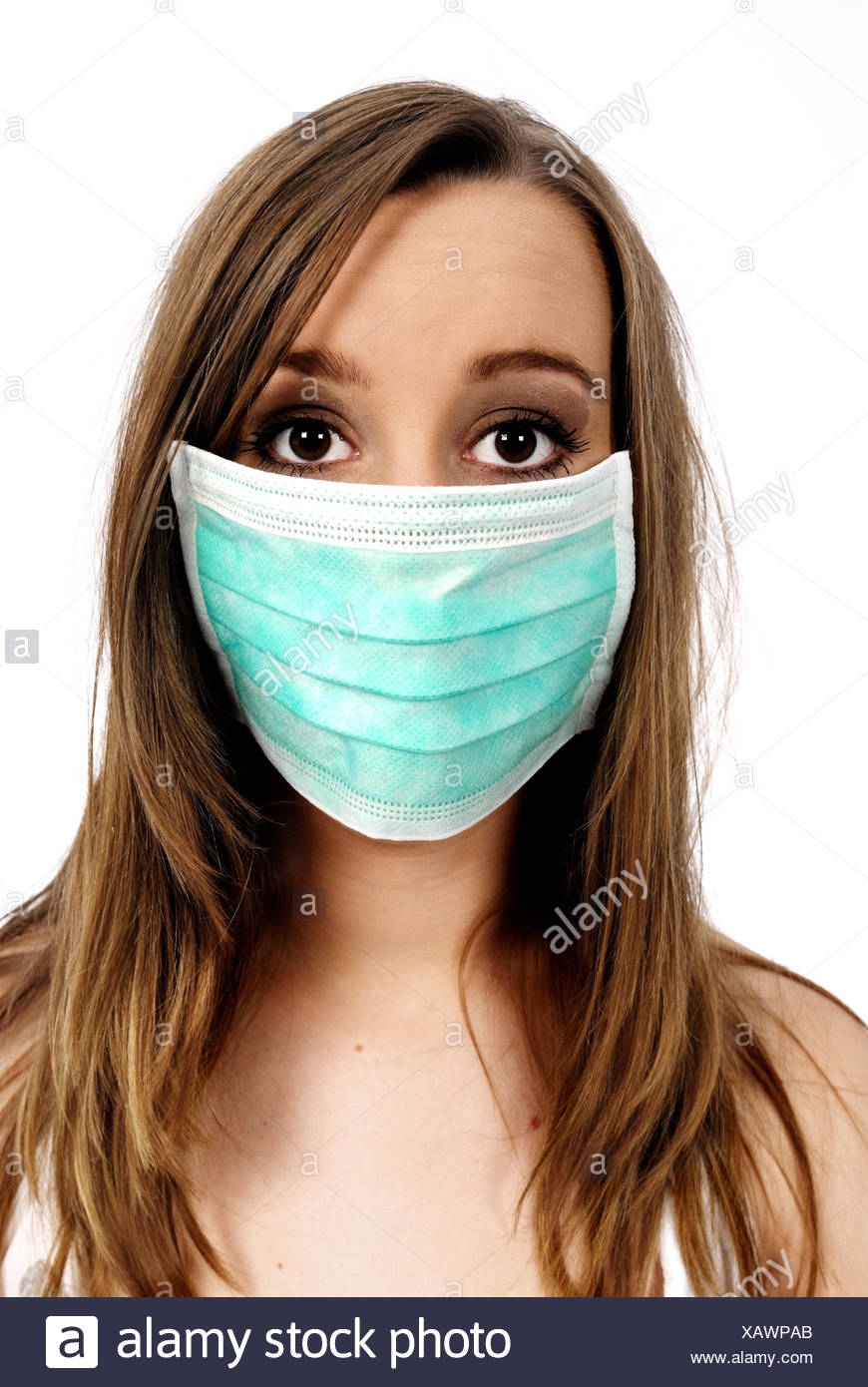 woman with green gumshield is afraid of influenza - Stock Image