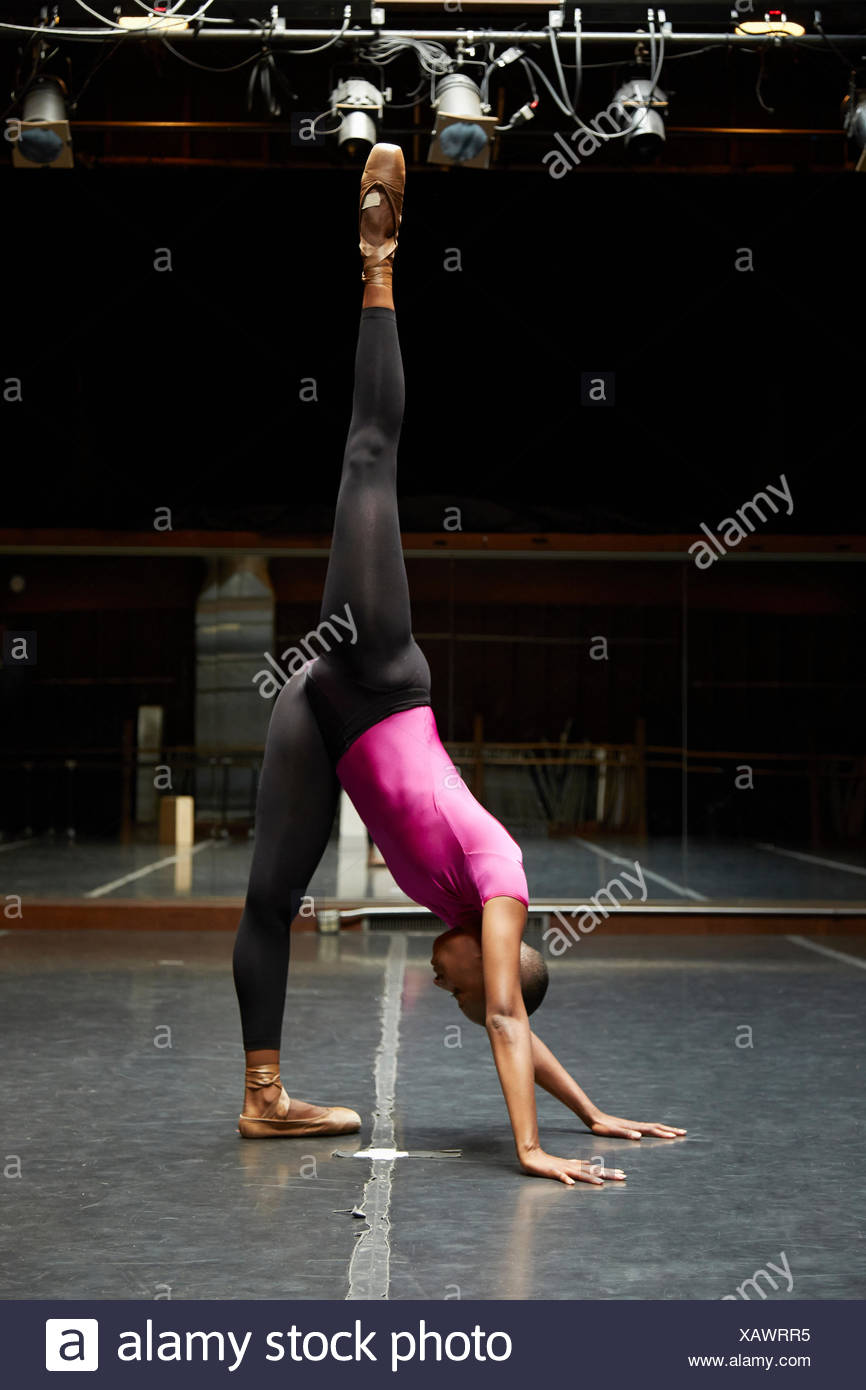 Ballet dancer going into handstand position - Stock Image