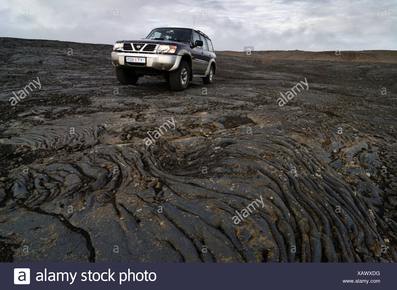 Jeep in the lava fields, highlands, Iceland, Europe - Stock Image