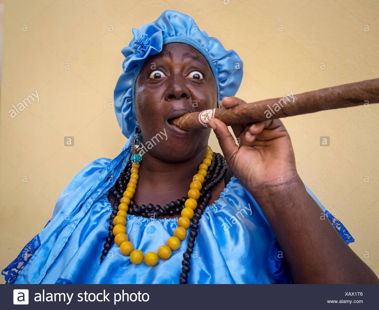 Portrait of a woman with an enormous cigar. - Stock Image