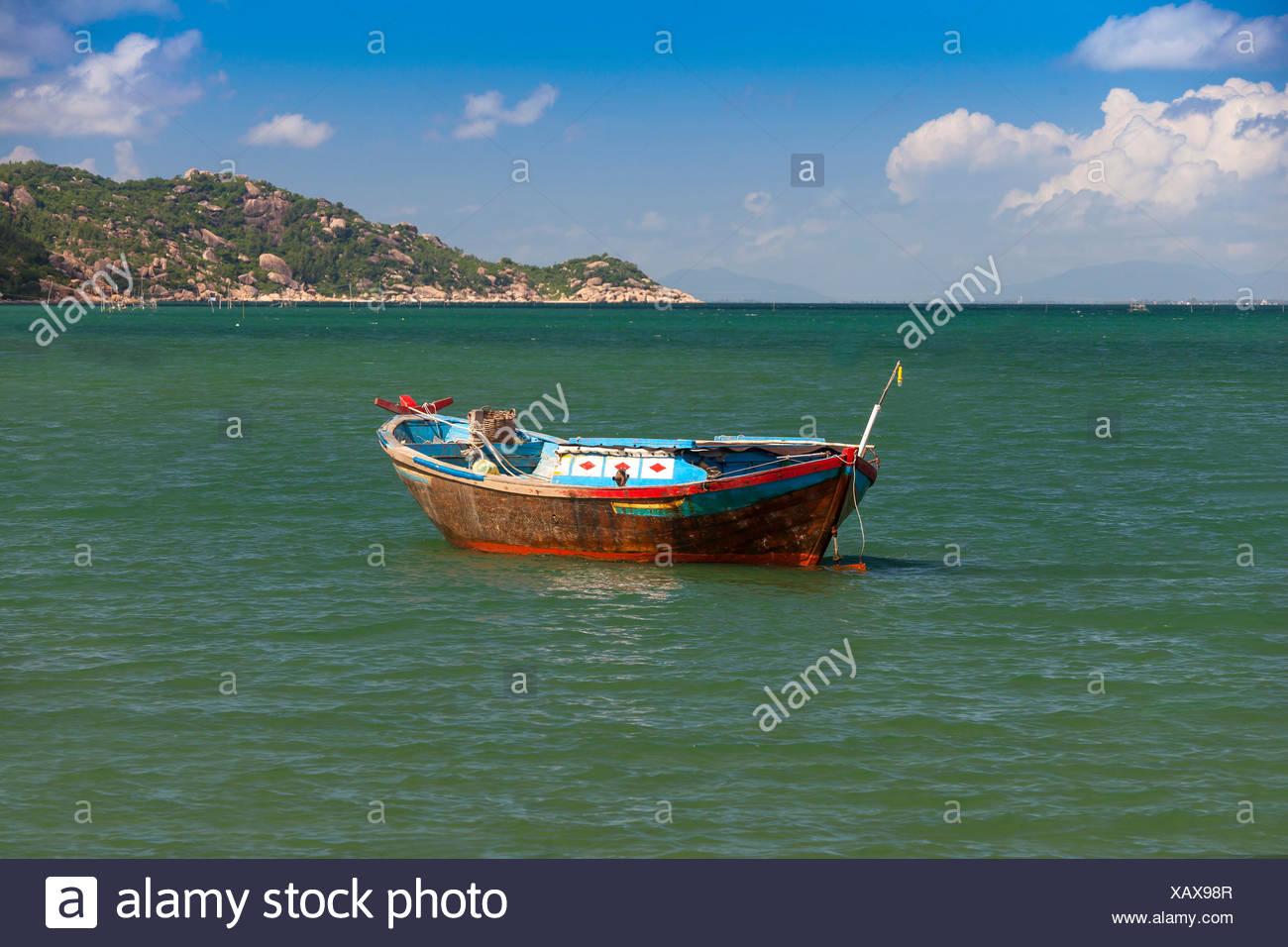 Fishing boat, Hon, Mun, bay, Vinpearl, island, South China Sea, sea, Asian, Asia, outside, mountains, mountainous, landscape, isl - Stock Image