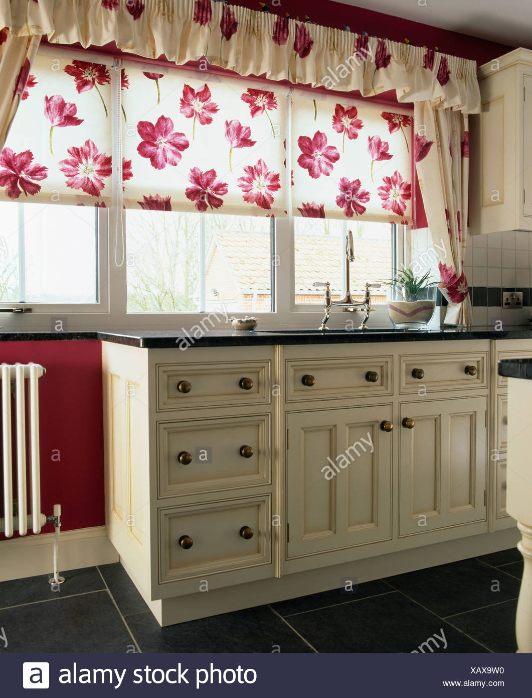 Red White Floral Blind On Window In Traditional Country Kitchen Stock Photo Alamy