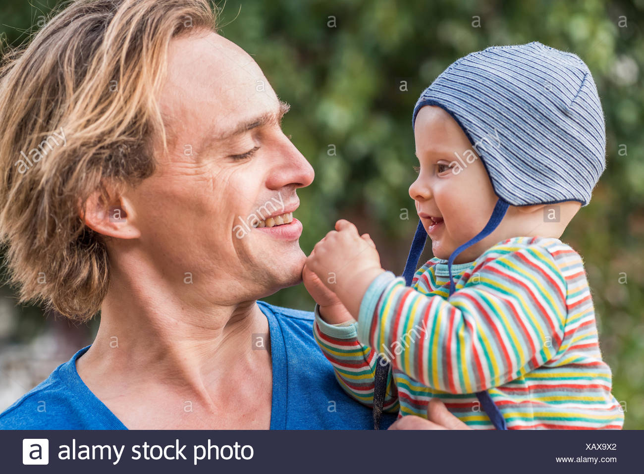 Man watching his little son - Stock Image