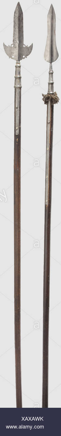 A German late medieval sword, mid-14th century,. Robust, double-edged blade with narrow fullers on both sides. Tubular quillons with widened conical finials. Heavy tang with original wooden grip scales and minor remnants of a fabric covering. Disk pommel with slightly bevelled edges. Length 113 cm, historic, historical, 14th century, pole weapon, weapons, arms, weapon, arm, fighting device, military, militaria, object, objects, stills, clipping, clippings, cut out, cut-out, cut-outs, metal, Additional-Rights-Clearences-NA - Stock Image