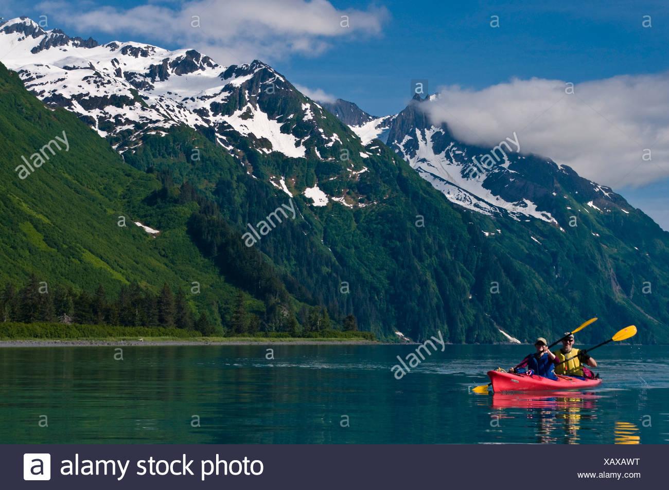 Couple kayaking in Shoup Bay, Prince WIlliam Sound, Alaska - Stock Image