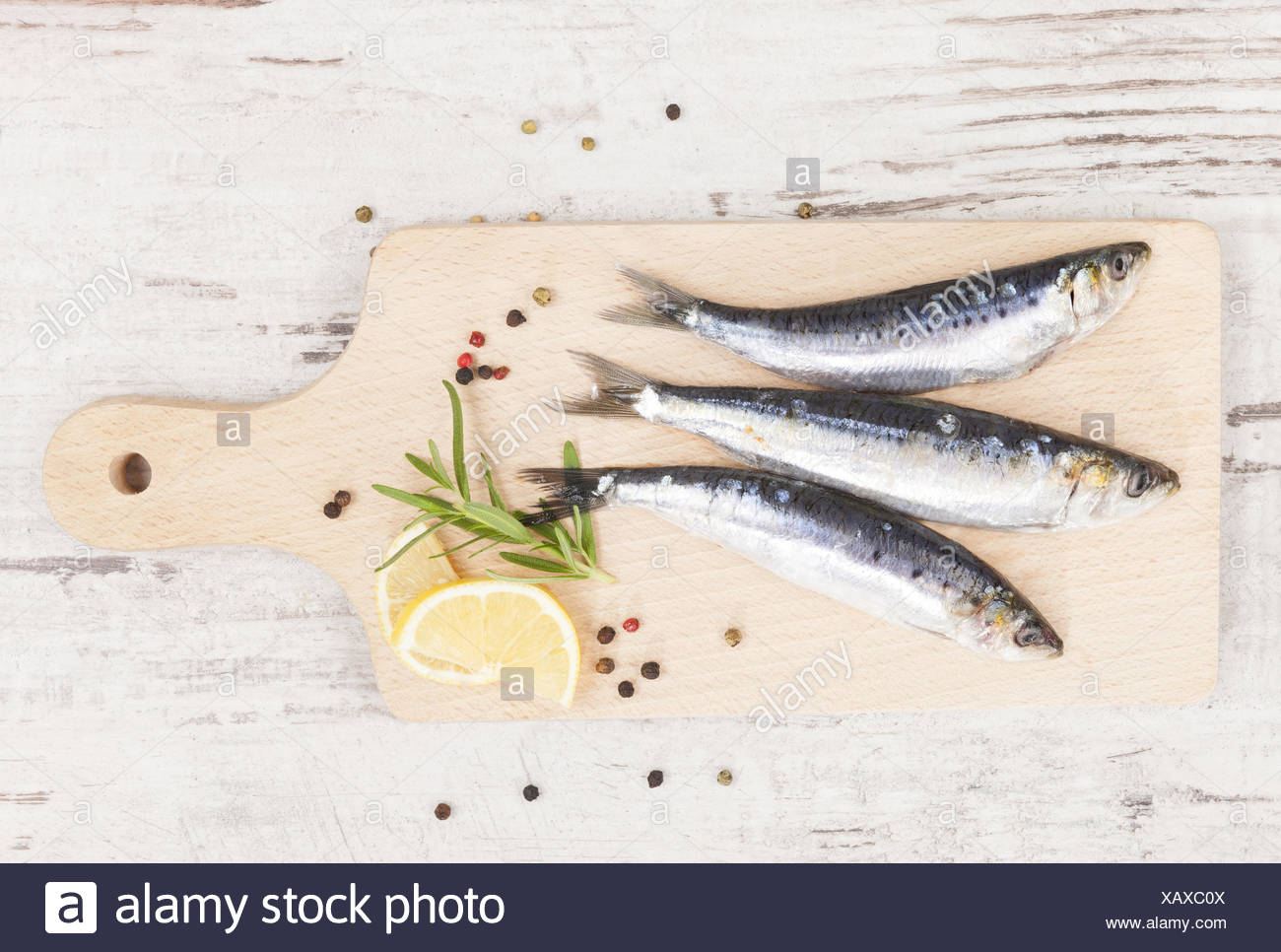Delicious anchovies fish eating. Stock Photo