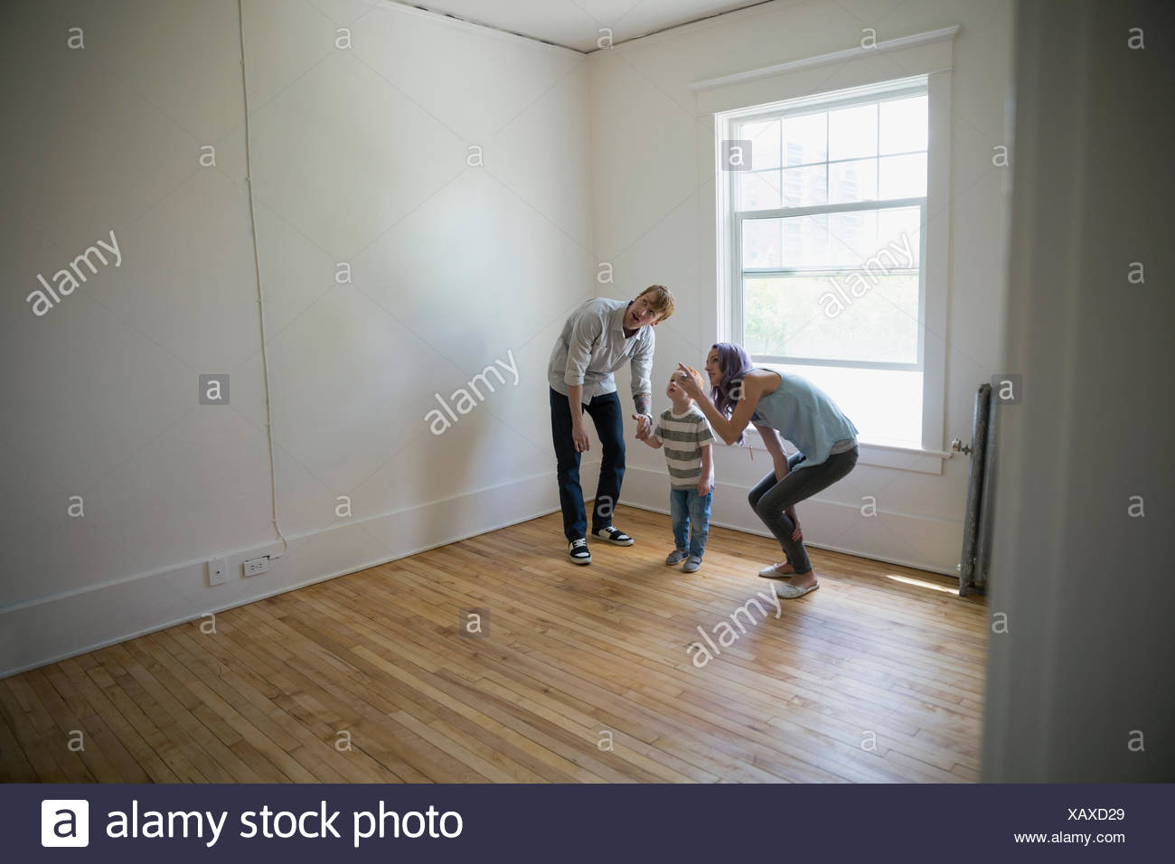 Young family in empty new house - Stock Image