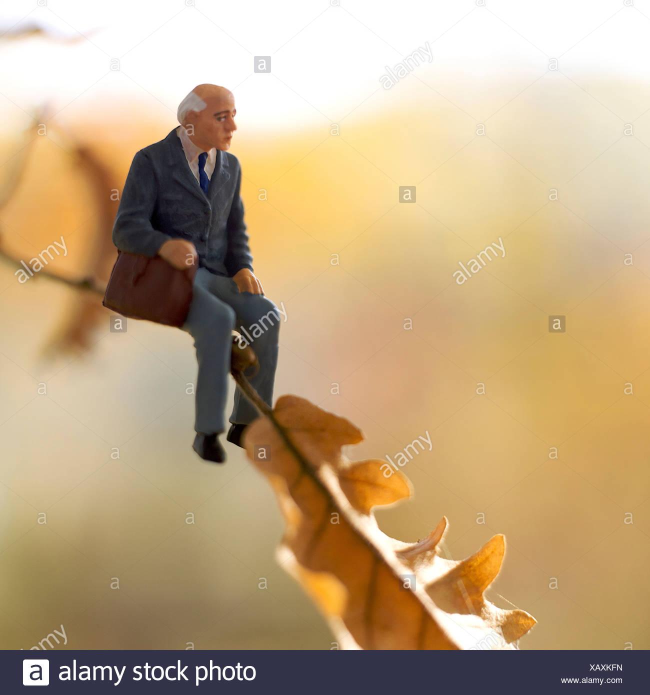 Solitary elderly male figure sitting alone - Stock Image
