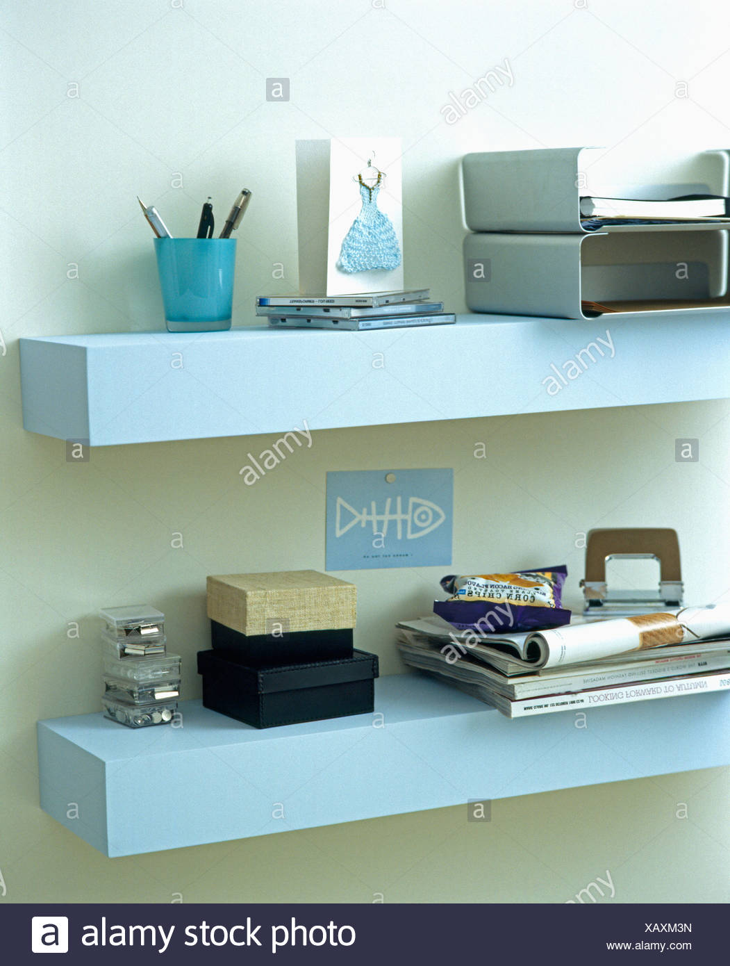 Close-up of pale blue Ikea  Lack  wall shelves with filing trays and small storage boxes & Close-up of pale blue Ikea