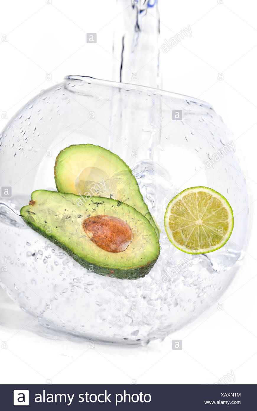 limes in water avocado - Stock Image