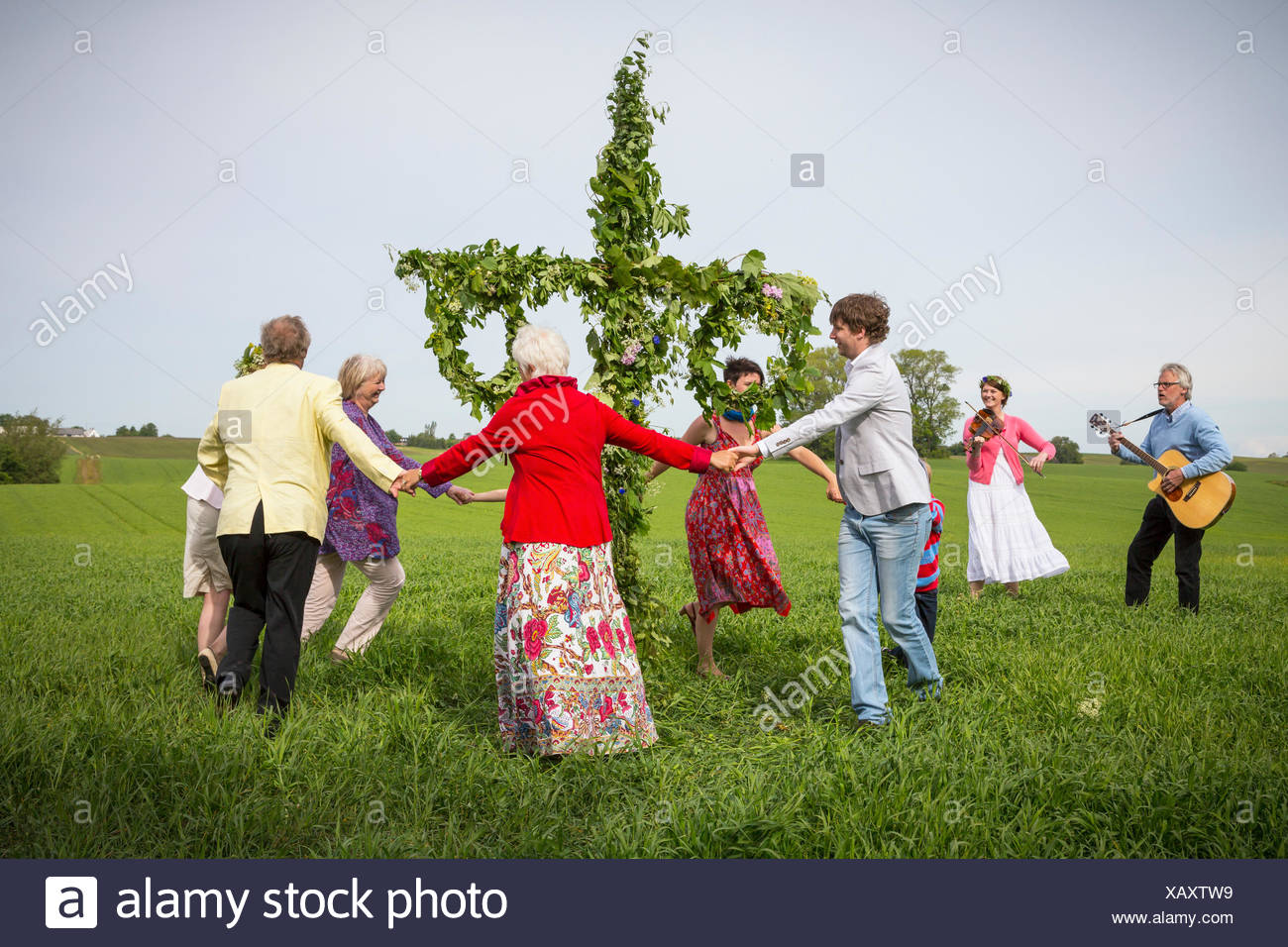 Sweden, Skane, Family with two children (6-7, 8-9) during midsummer celebrations - Stock Image