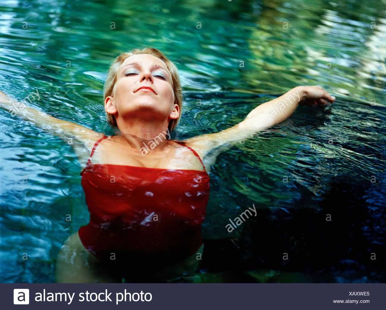 A Scandinavian woman in the water. - Stock Image
