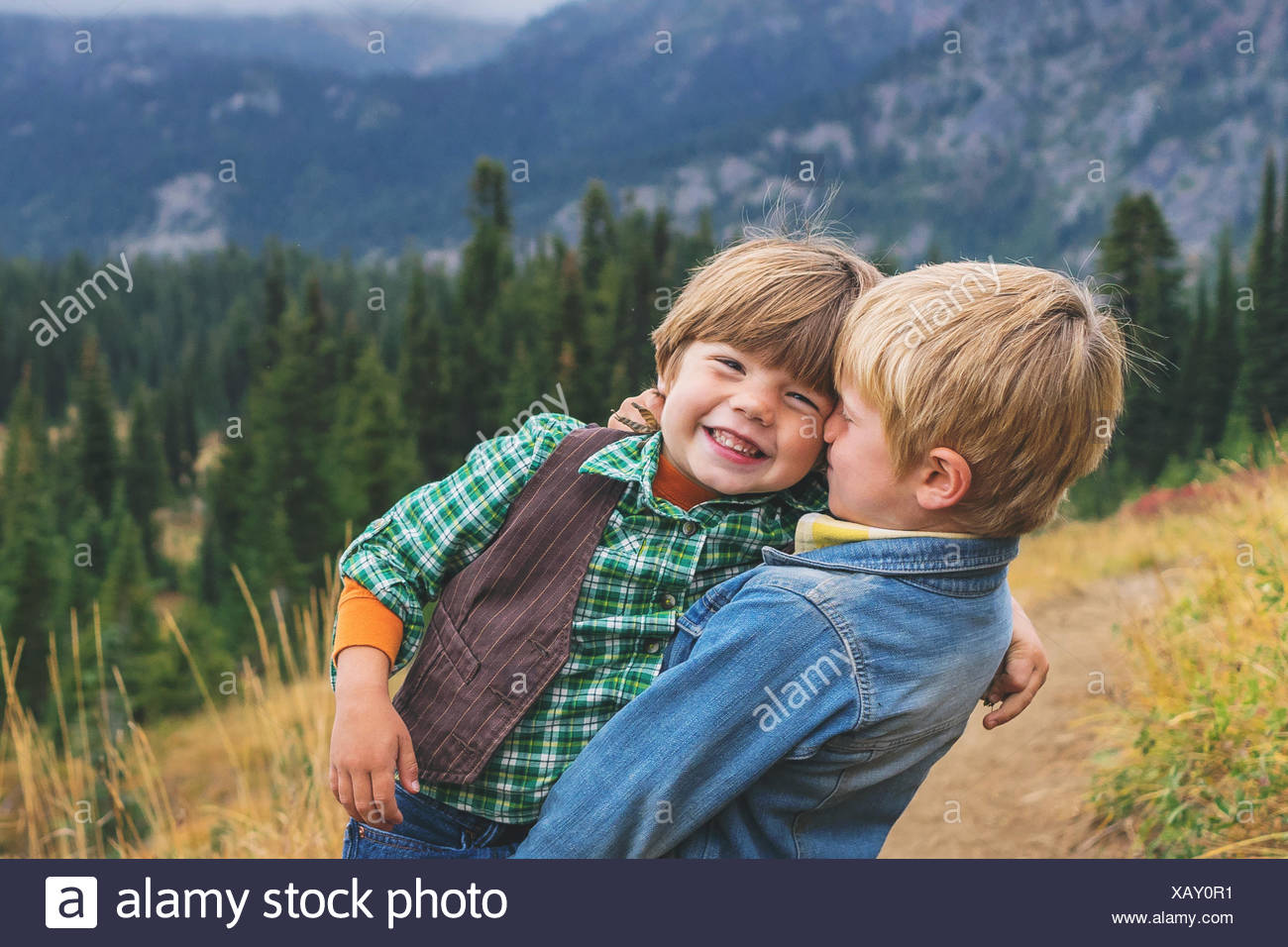 Two smiling boys messing about - Stock Image