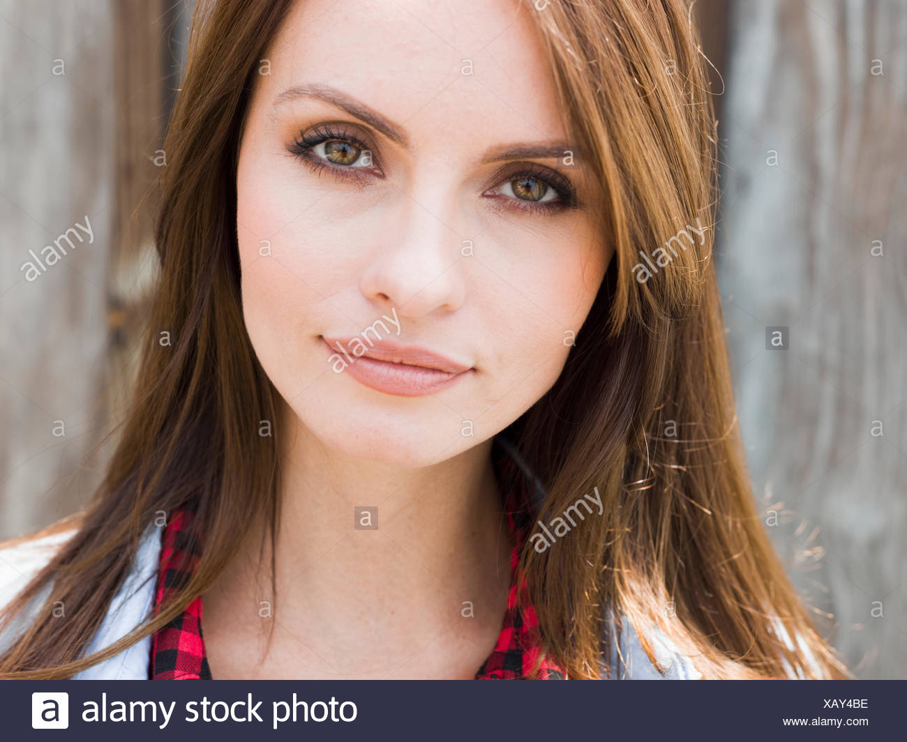 A young woman with brown eyes. - Stock Image