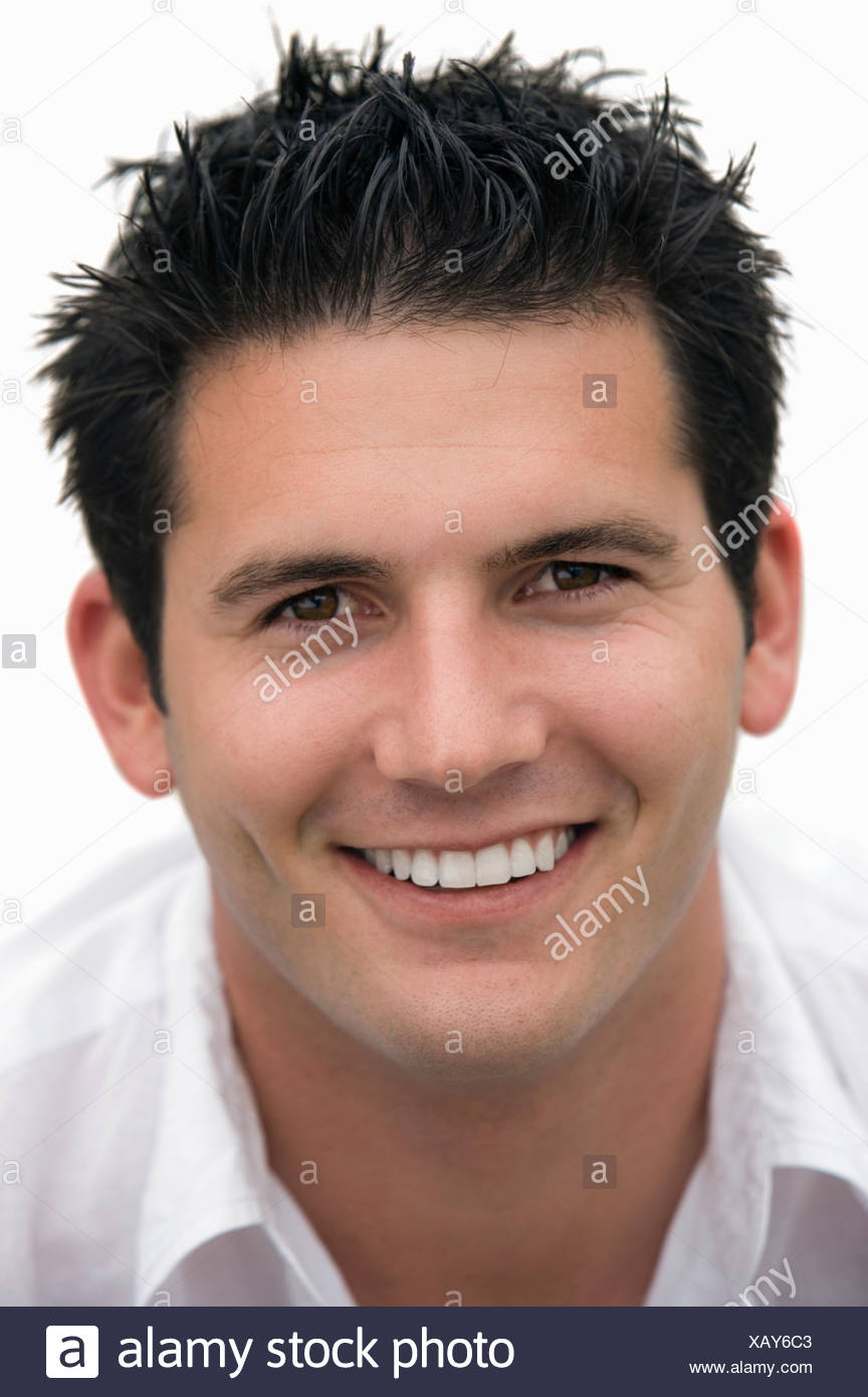 close-up of young man with spiked hair, cut out - Stock Image
