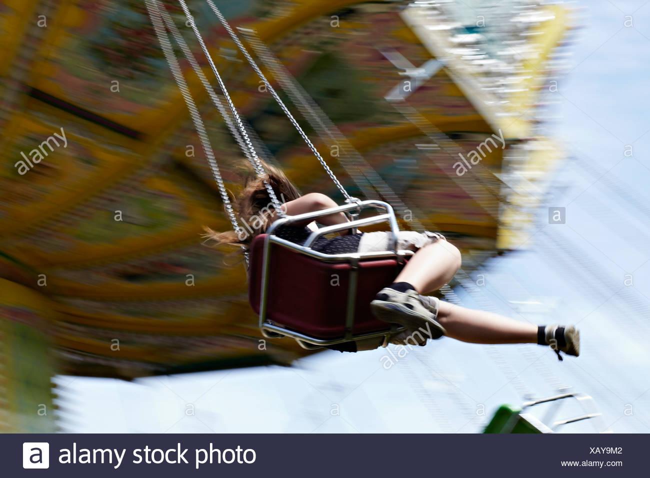 Girl  Sitting On Amusement Park Ride, Bad Woerishofen, Bavaria, Germany, Europe - Stock Image
