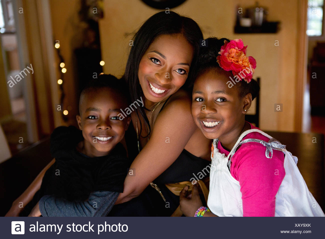 Portrait of mother with son and daughter - Stock Image