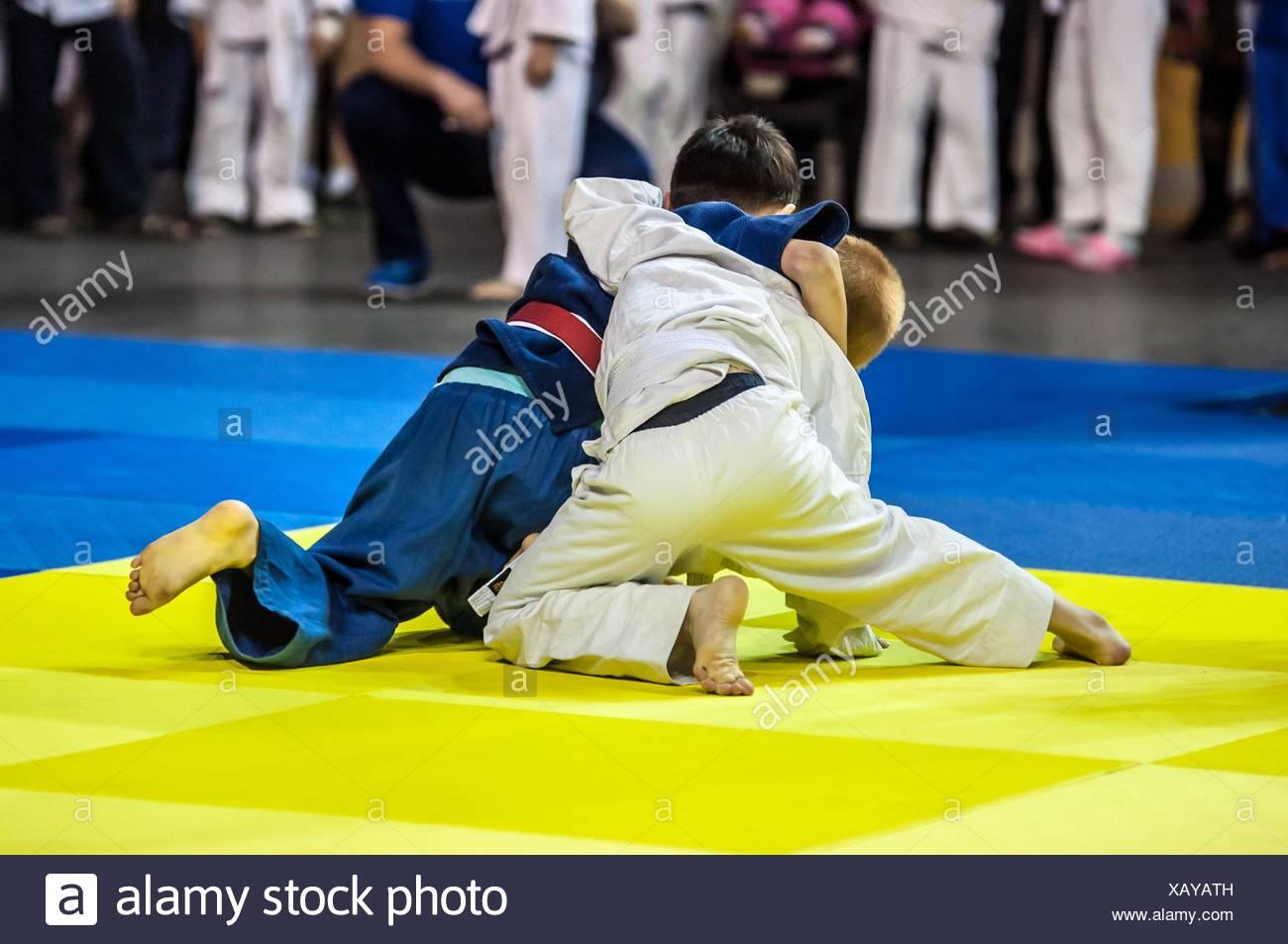 Two judoka on the tatami. Stock Photo