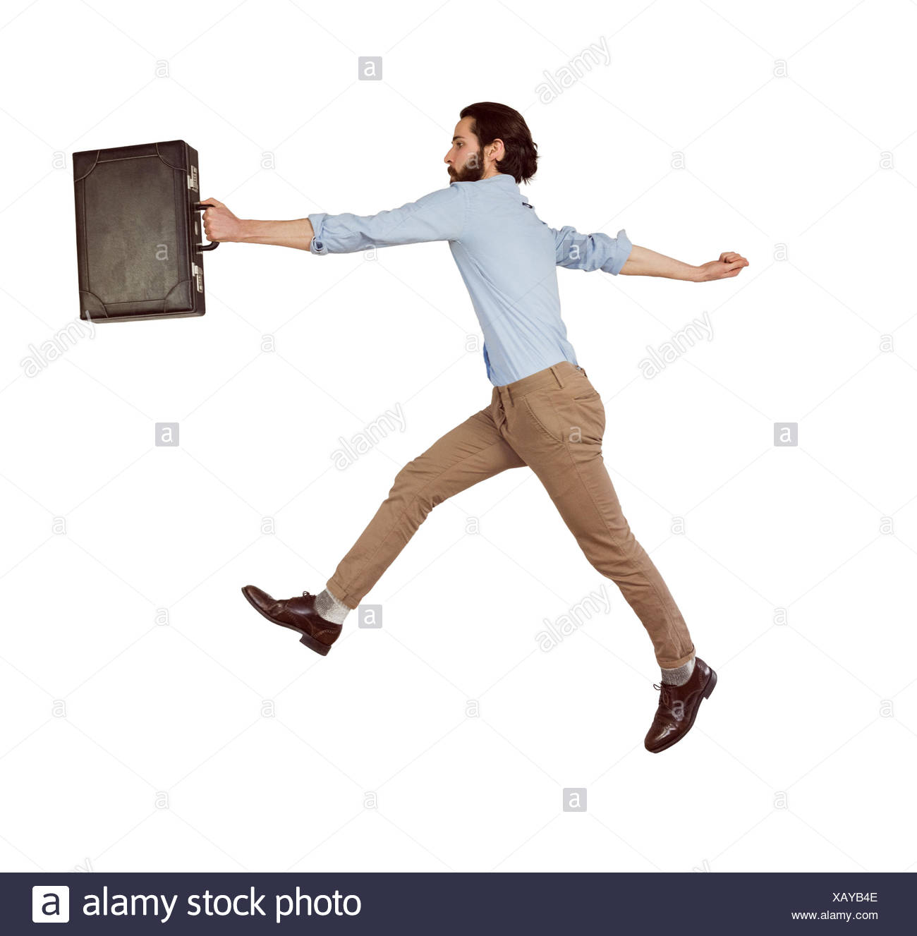 Handsome hipster leaping with briefcase - Stock Image