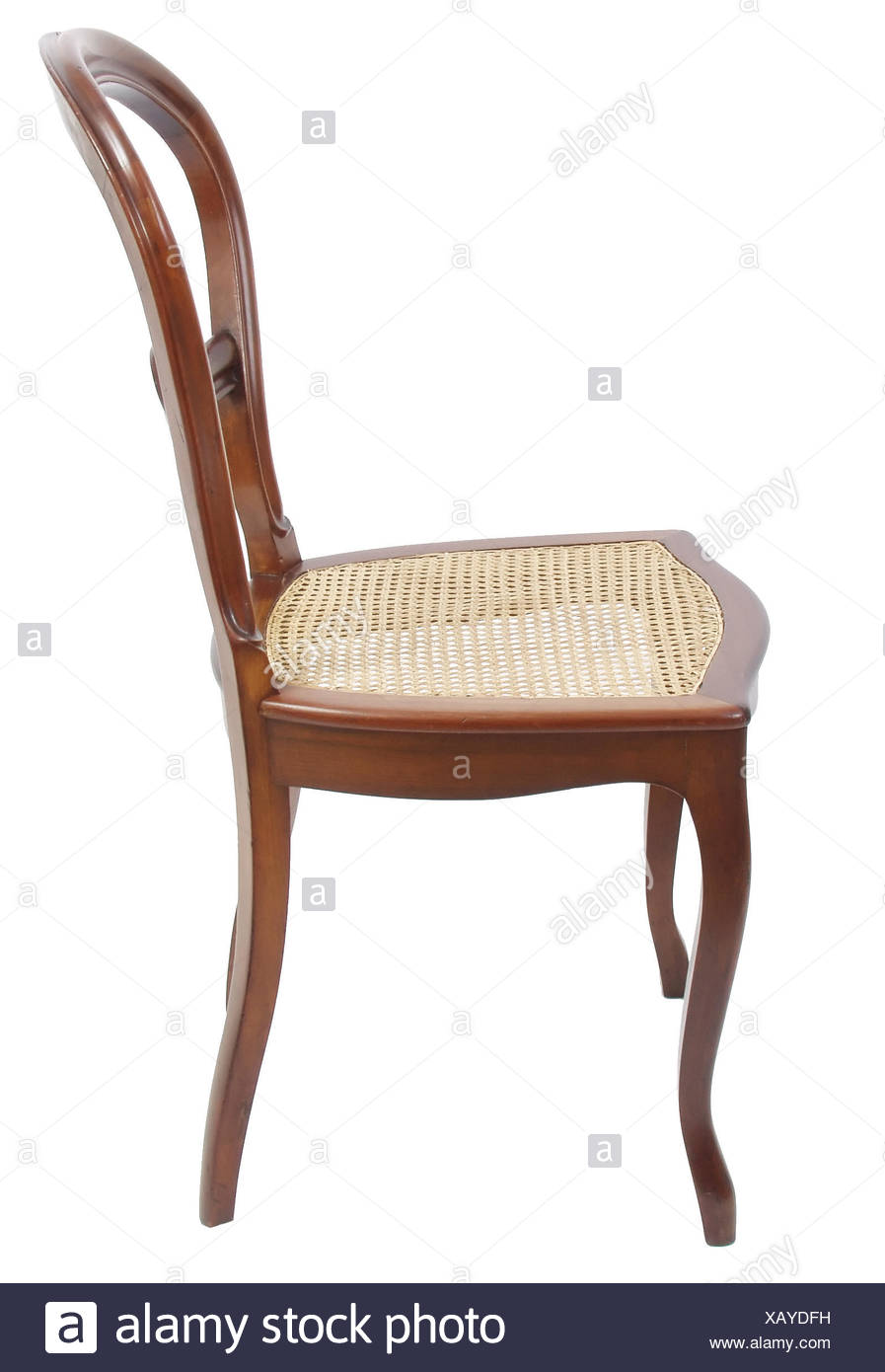 Antiker Stuhl mit Bespannung vor weißem Hintergrund Stock Photo