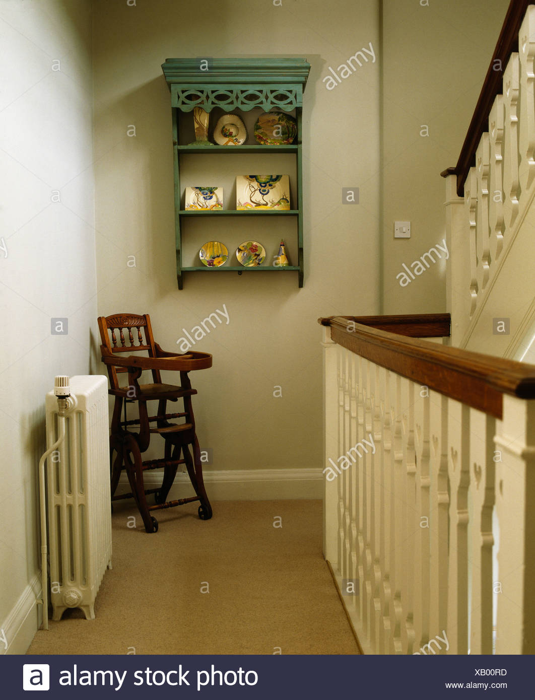 Small Green Shelves On Wall Above Childu0027s Antique High Chair On Traditional  Cream Landing