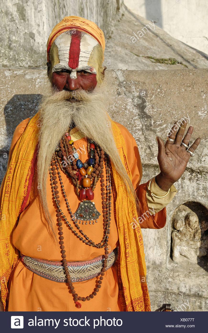 Sadhu holy man Pashupatinath Katmandu Nepal Himalayas Asia Asian asceticism ascetic ascetically beard whiskers painted face - Stock Image