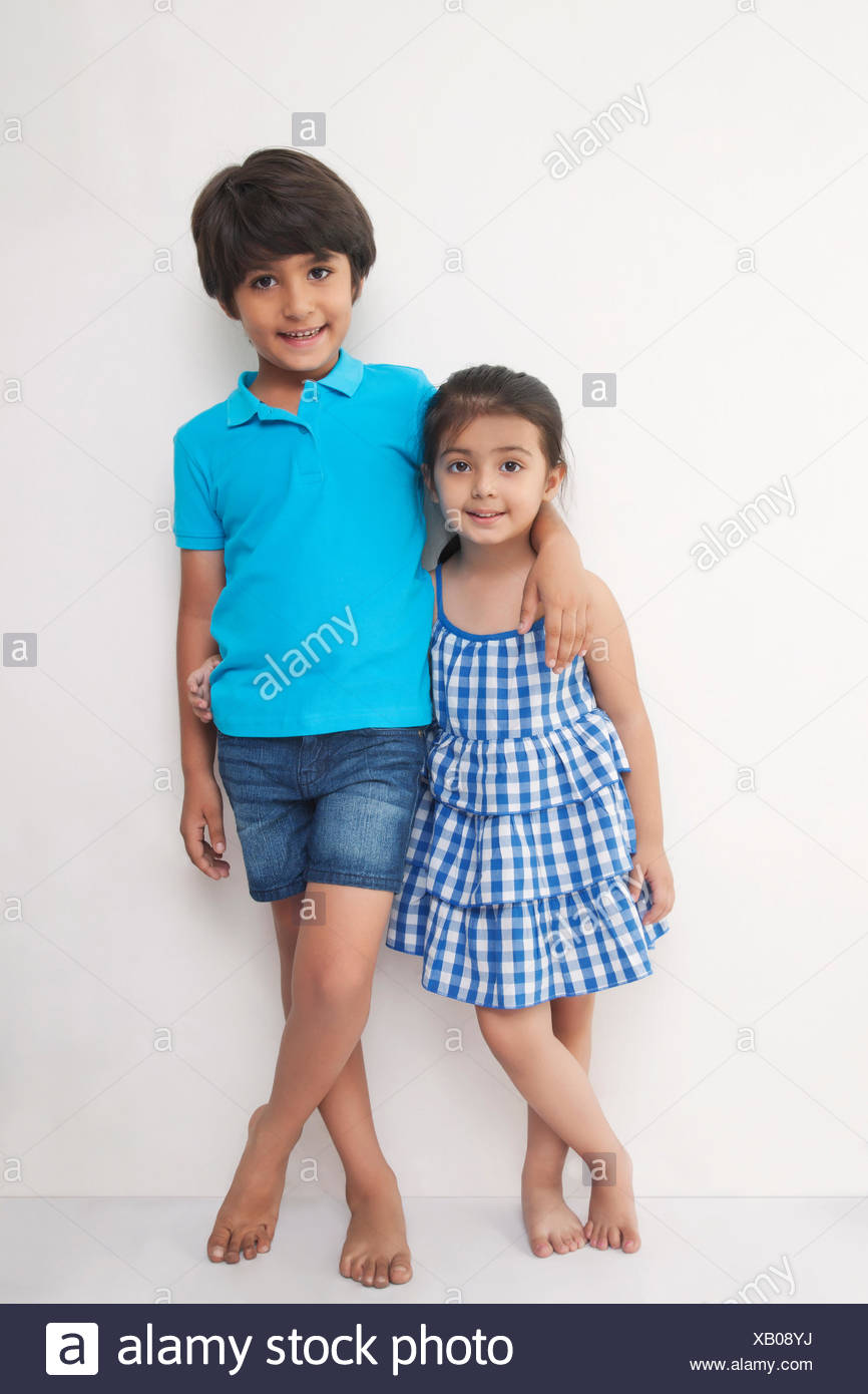 Portrait of happy brother arm around his sister - Stock Image