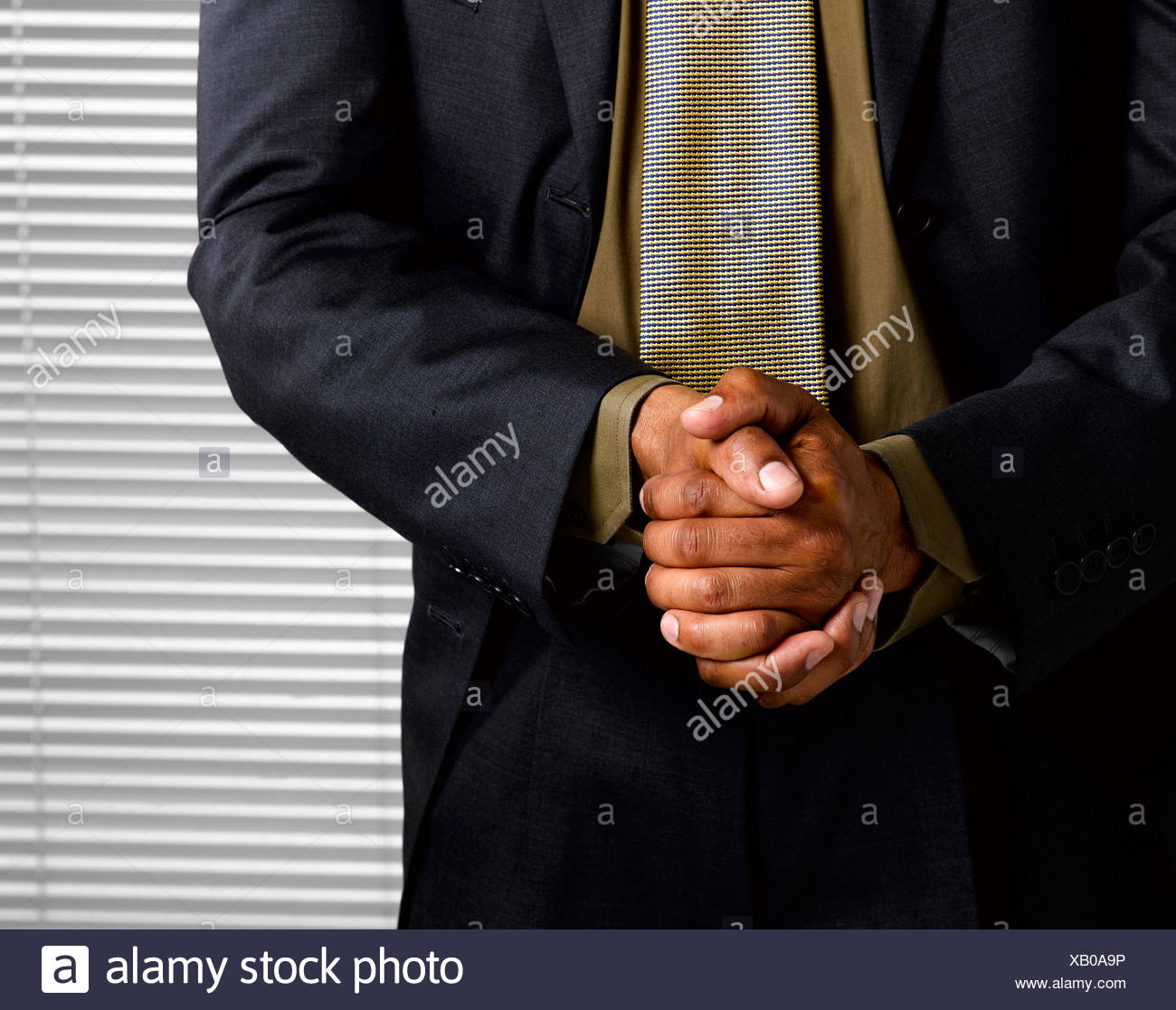 Business man wringing hands together - Stock Image