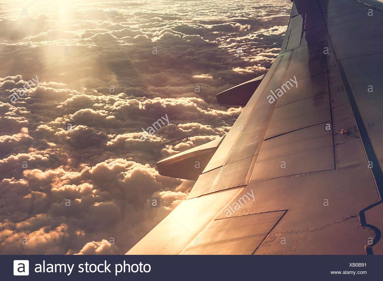 View of clouds, taken from aeroplane window - Stock Image