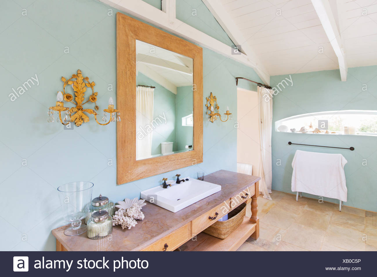 Sink and mirror in rustic bathroom - Stock Image